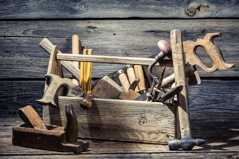 Old joinery tool box. On old wooden table royalty free stock photo