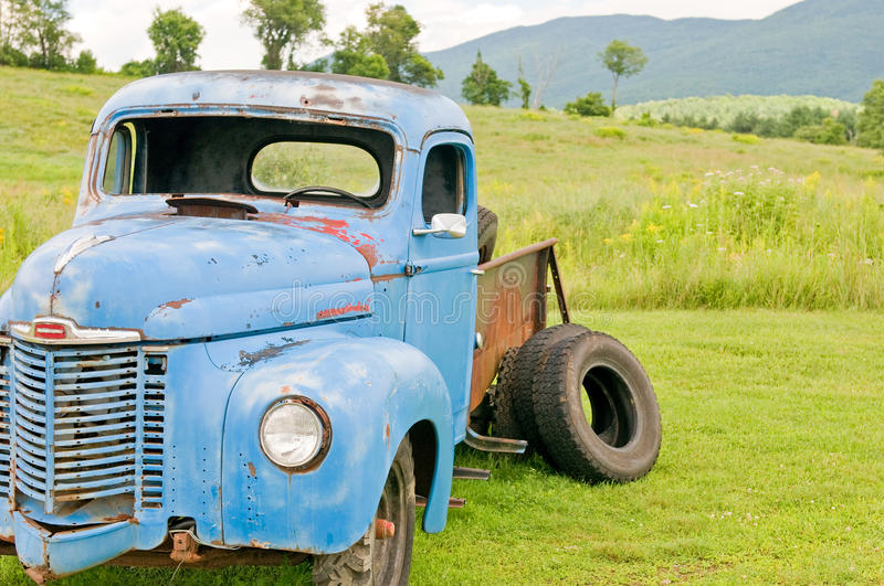 Old junk farm truck. In a rural country field. Vermont (USA royalty free stock photo