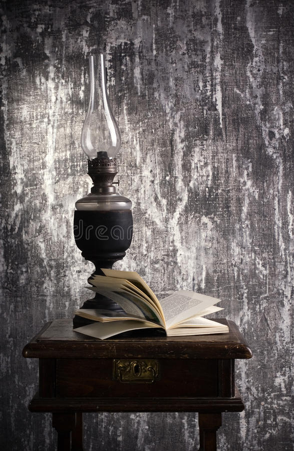 Free Old Kerosene Lamp And Open Book Royalty Free Stock Images - 21698919
