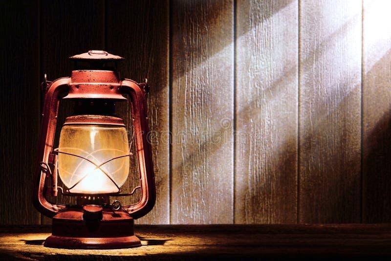 Old Kerosene Lantern Lamp in Rustic Country Barn royalty free stock photography