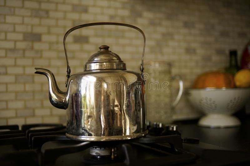 Old kettle close-up stove black table bokeh background stock photos
