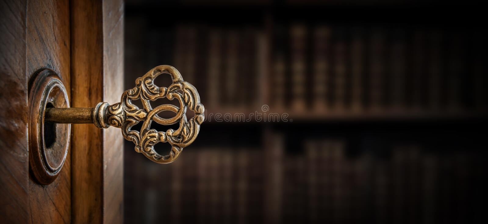 Old key in keyhole. Retro style. Concept and Idea for History, business, security background. Write Your Text Here. Old key in keyhole, macro shot. Retro style royalty free stock images