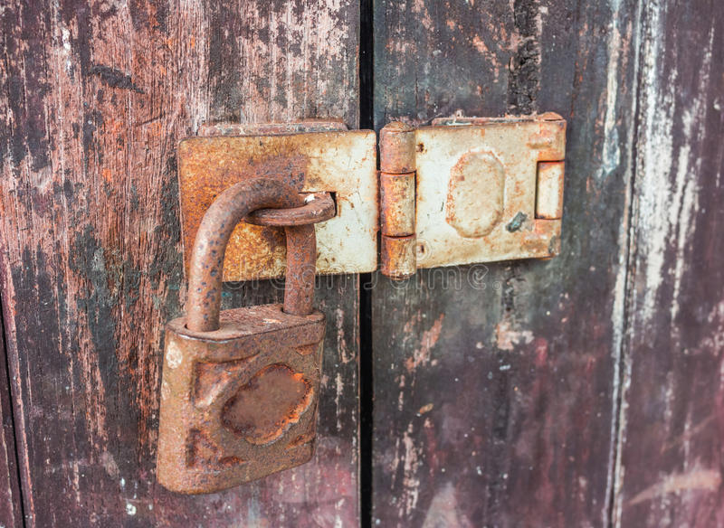 Old key lock on wooden wall stock image