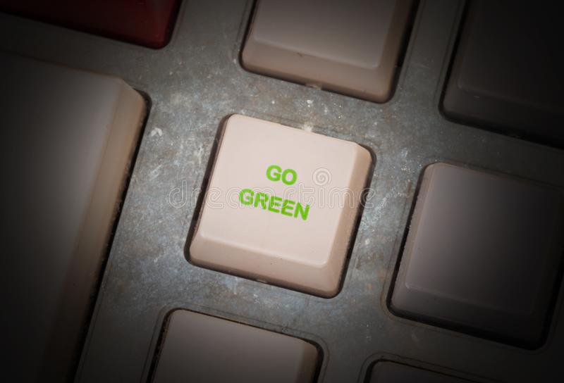 Old button - Go green. Old keyboard button, selective focus - Go green royalty free stock photography