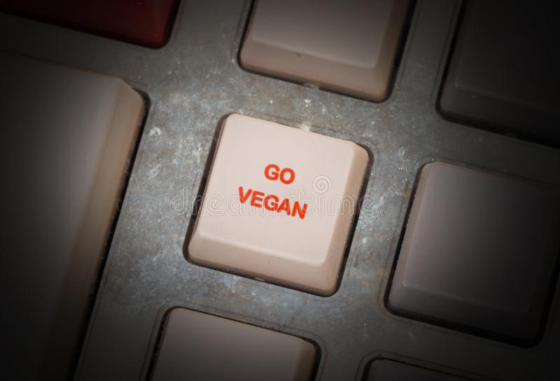 Old button - Go vegan. Old keyboard button, selective focus - Go vegan royalty free stock image