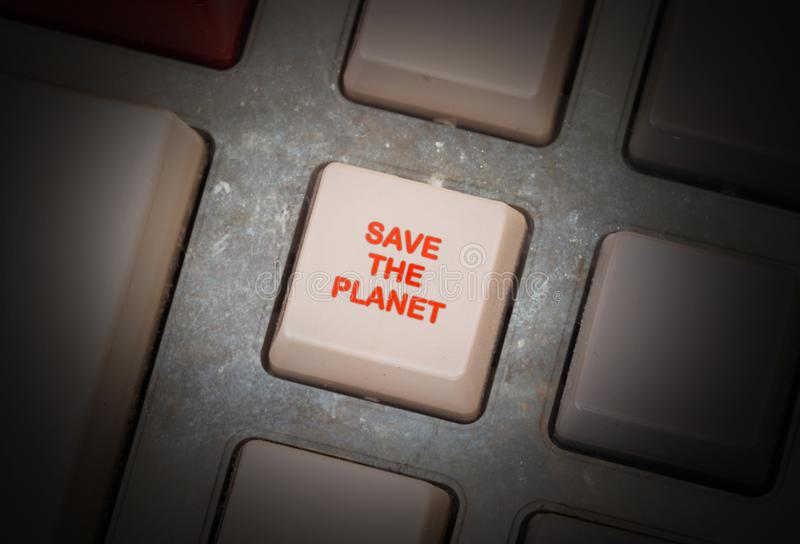 Old button - Save the planet. Old keyboard button, selective focus - Save the planet royalty free stock photo