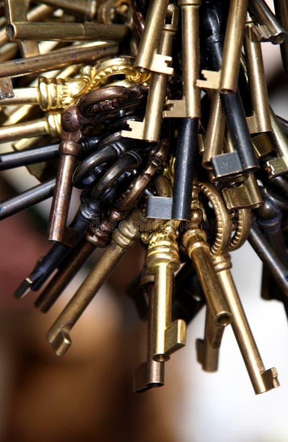Old keys. Old vintage keys hanging with blurry background royalty free stock image