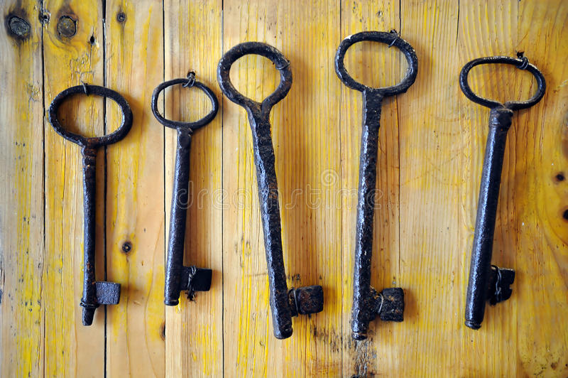 Old keys. Old metal keys at a wooden wall stock photos