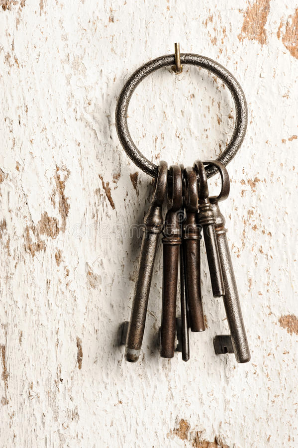 Old keys. Group on wall stock images