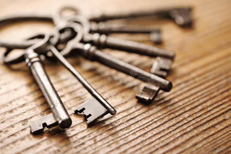 Old keys. On a wooden table, close-up royalty free stock photos
