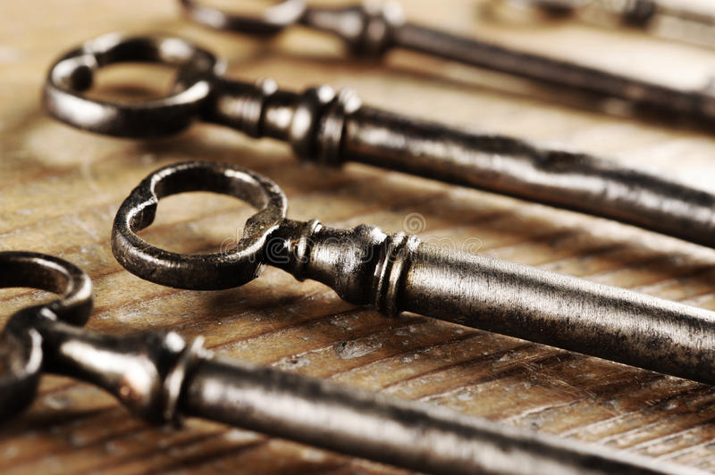 Old keys. On a wooden table, close-up stock image