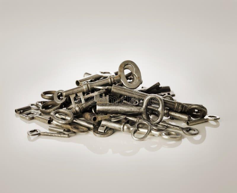Old Keys. A Pile of old metallic keys stock images