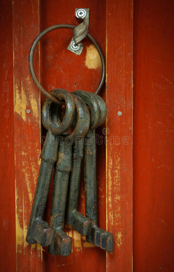 Old keys. Rusty old vintage iron keys hanging on a hook stock photos