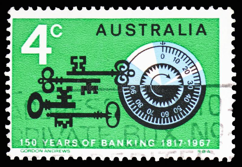 Old keys, combination lock, 150 years bank of Australia serie, circa 1967. MOSCOW, RUSSIA - FEBRUARY 10, 2019: A stamp printed in Australia shows Old keys stock image