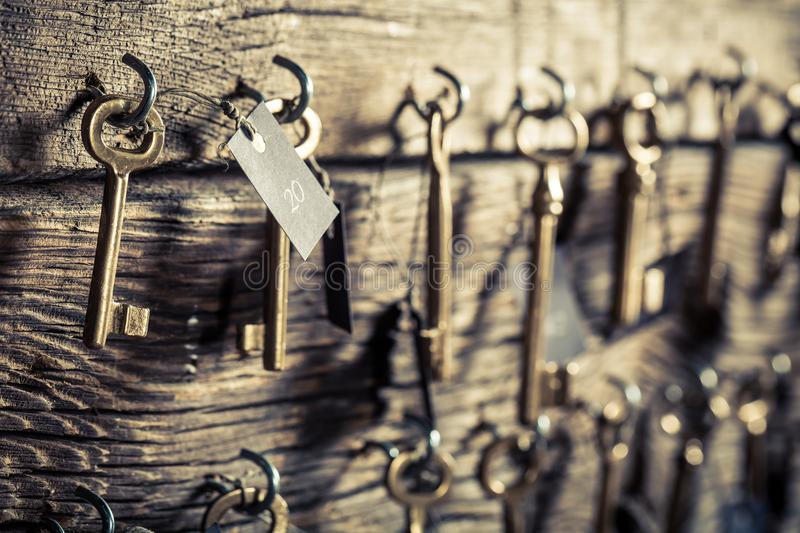 Old keys for hotel rooms. Closeup of old keys for hotel rooms royalty free stock images