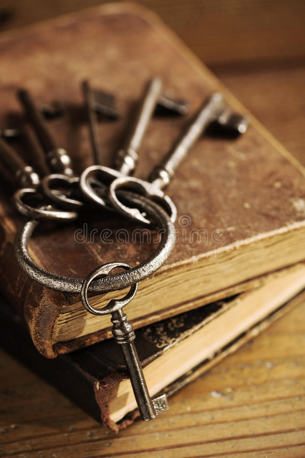 Old keys on a old book. Antique wood is background stock photography