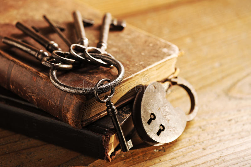 Old keys on a old book. Antique wood is background royalty free stock photography