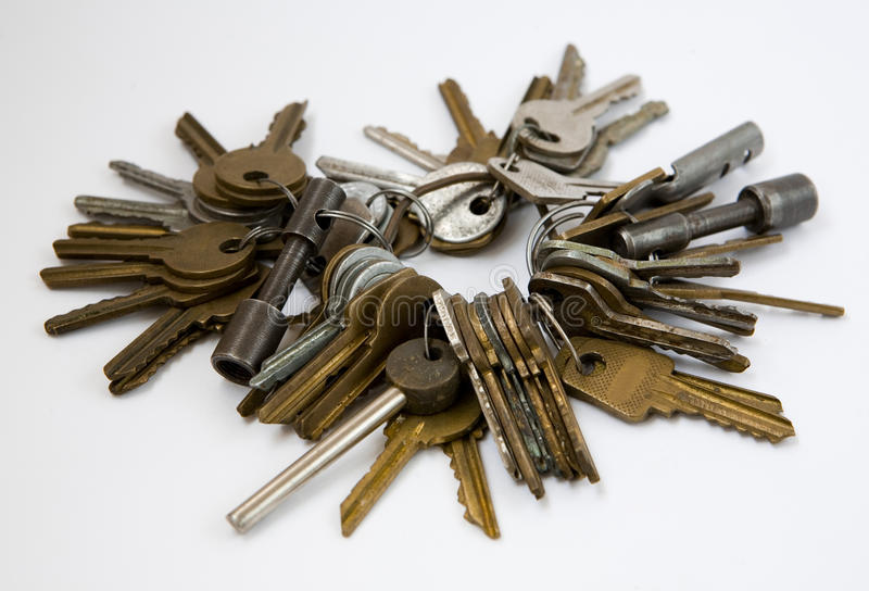 Old keys on a ring. Close-up shot of old keys on a ring on white background royalty free stock photography