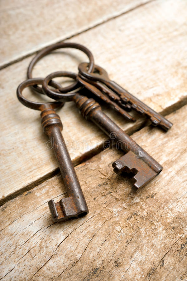Old keys. With ring on wooden background stock images