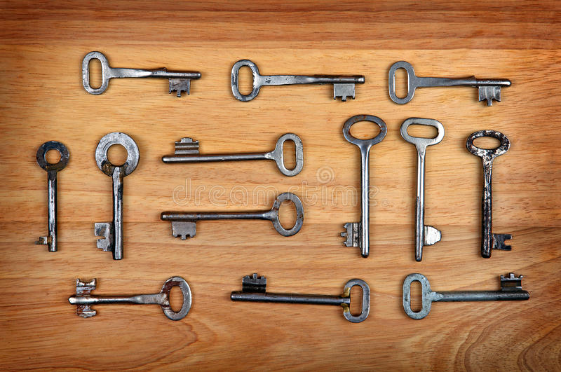 Old Keys Set. On the Wooden Background royalty free stock photos