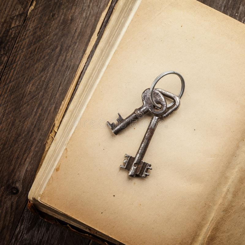 old keys on a vintage book stock image