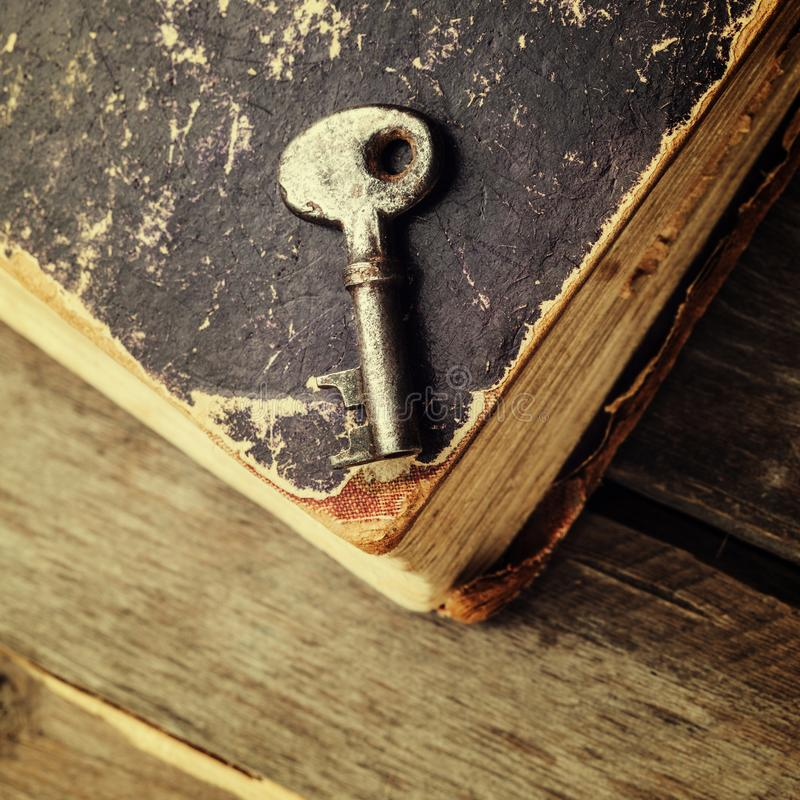 old keys on a vintage book stock photos