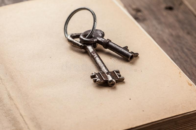 old keys on a vintage book stock photo