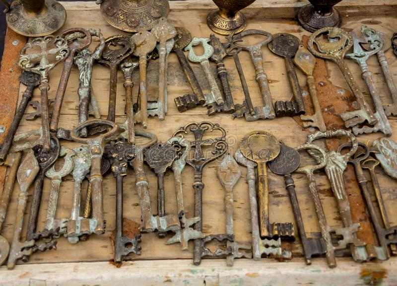 Old keys on a wooden table, close-up royalty free stock images