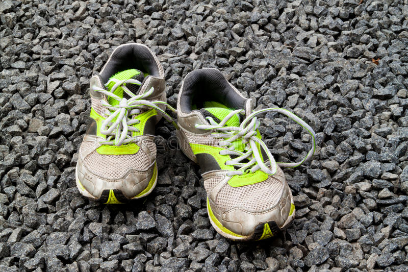 Old kids running shoes stock photography