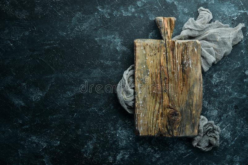 Old kitchen wooden board. Top view. Free copy space stock photo