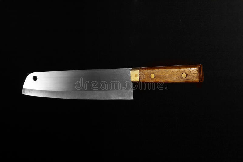 Old knife. With brown handle isolated on a black background royalty free stock photography