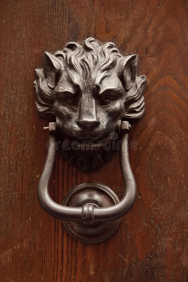 Old knocker on a door stock image