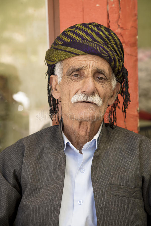 Old Kurdish man. Portrait of Kurdish old man wearing kurdish custome and hat in Sualimanya city in Iraq