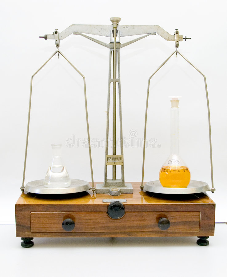 Old lab scale weighing. An old style weighing machine in a lab, weighing some liquids royalty free stock images