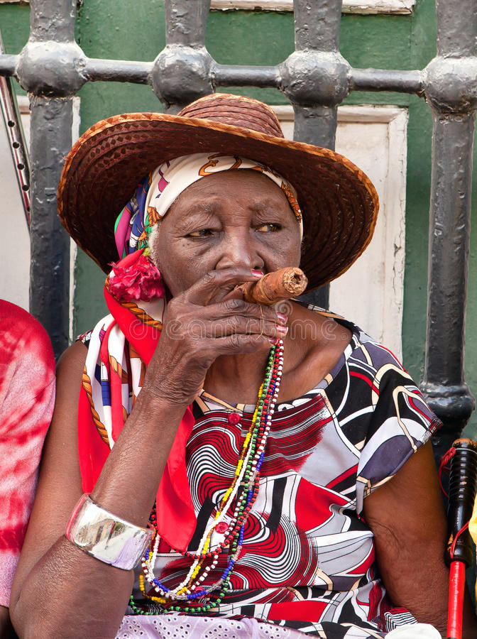 Old lady with a cigar stock photography