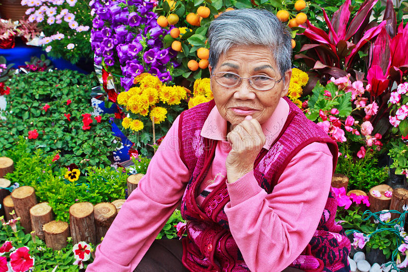 Download Old Lady In Front Of Flower Garden Stock Image - Image: 33598027