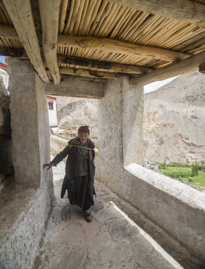 Old lady going for prayers in Monastery near Lamayuru in Ladakh, India stock images