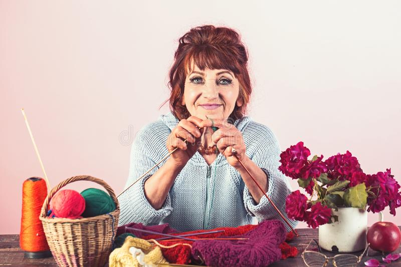 Old lady or grandmother with needle and yarn. stock photos