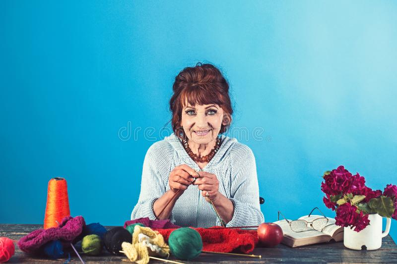 Old lady or grandmother with needle and yarn. royalty free stock images