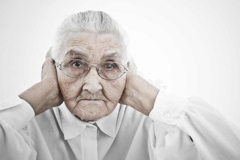 Grandmother doesn't want to hear anything royalty free stock photography