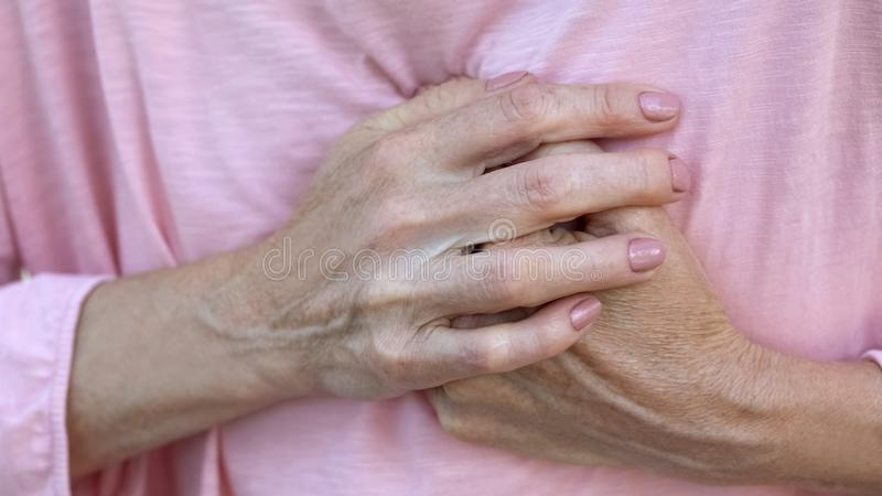 Old lady holds hands on chest, progressive breast cancer, bad diagnosis, pain. Stock photo royalty free stock photos