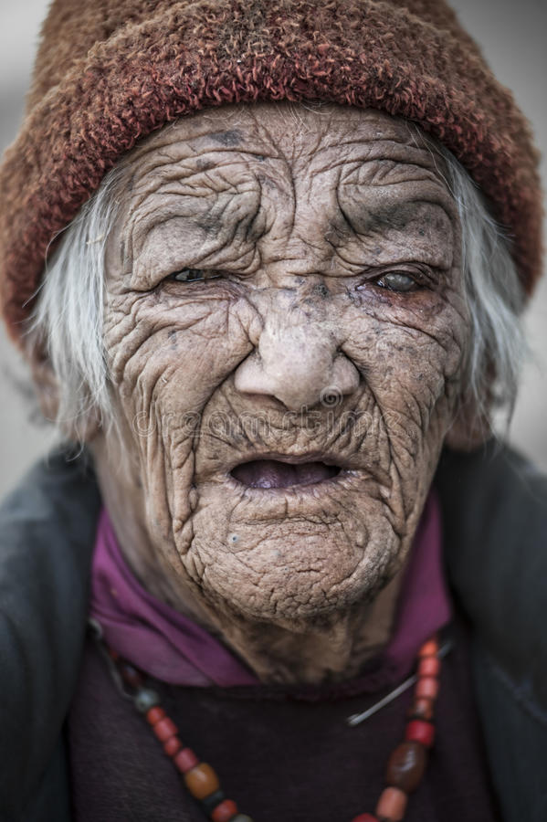 Old lady from Lamayuru village with eye problems cataracts glaucoma royalty free stock photography