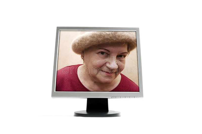 Old lady in the monitor stock photos
