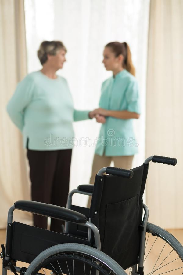 Old lady and nurse. Photo of old lady and nurse in rest home royalty free stock photography