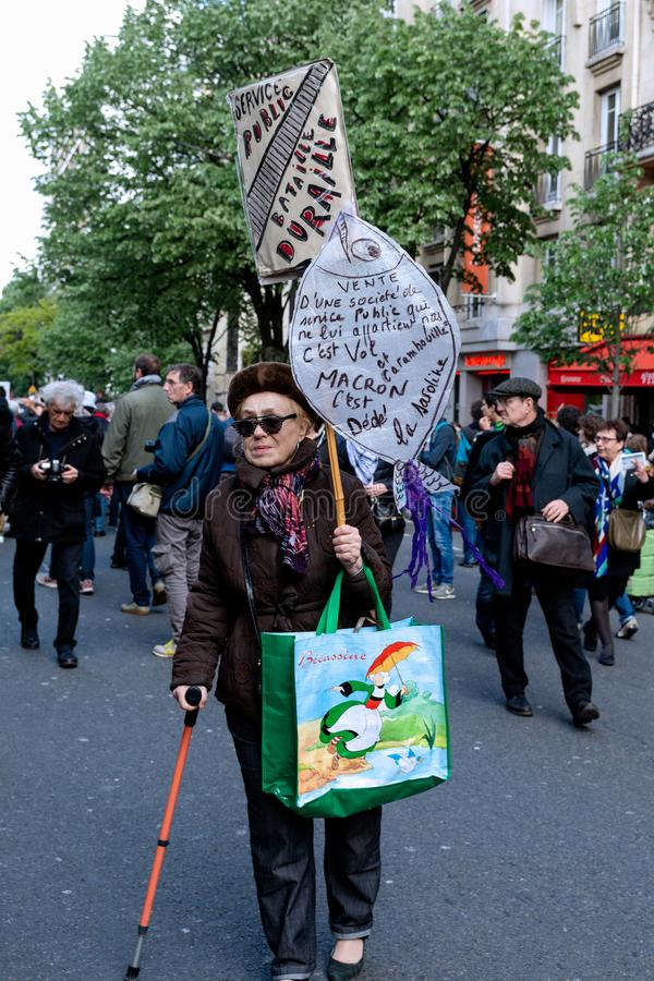 May 2018 - Anti Macron protest in Paris. An old lady in Paris for Anti Macron Protest Parade royalty free stock images