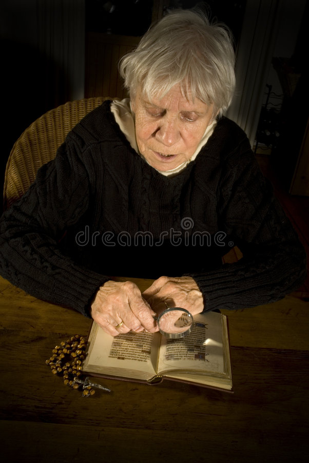 Download Old lady reading in bible stock photo. Image of lady, furrows - 3928378