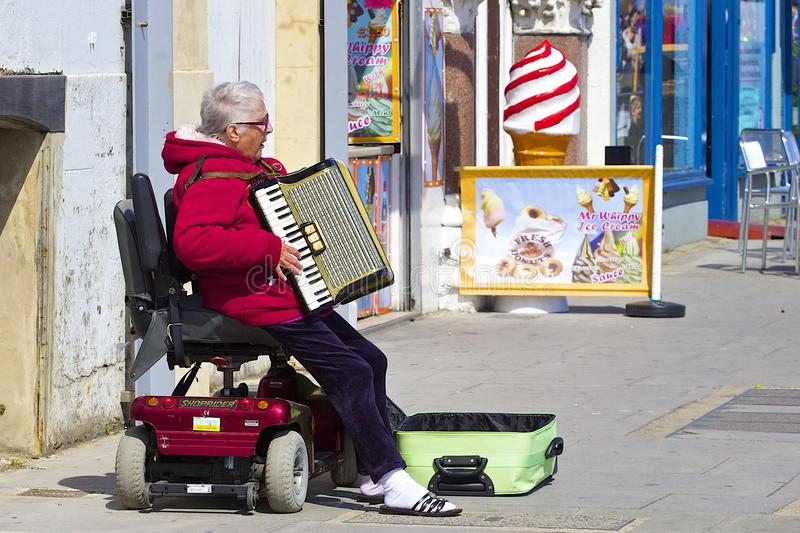 Old lady singing in the street royalty free stock photos
