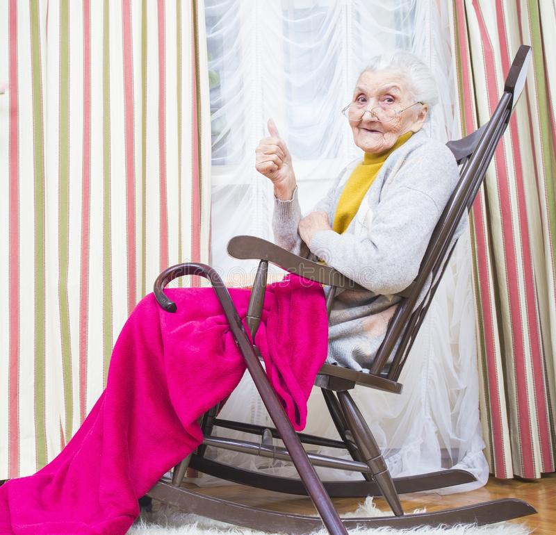 Old lady thumbs up stock photos