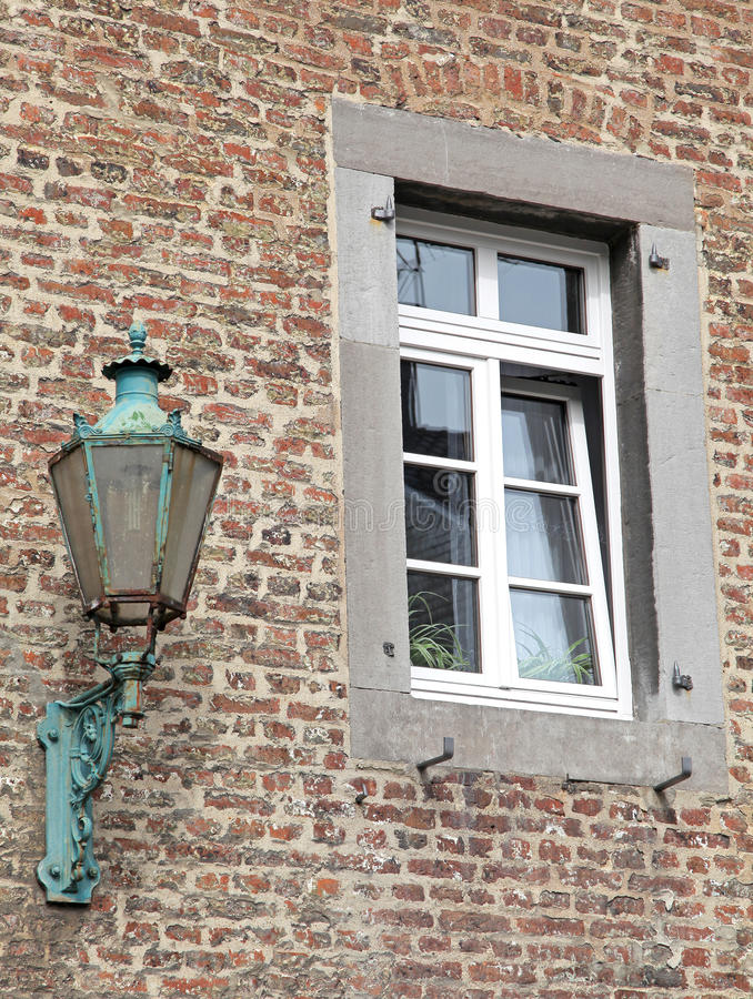 Old lamp at the building - Aachen, Germany stock photography