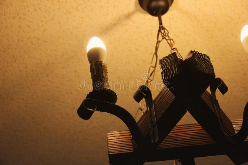 Old lamp. Electric light in the form of a candle royalty free stock images